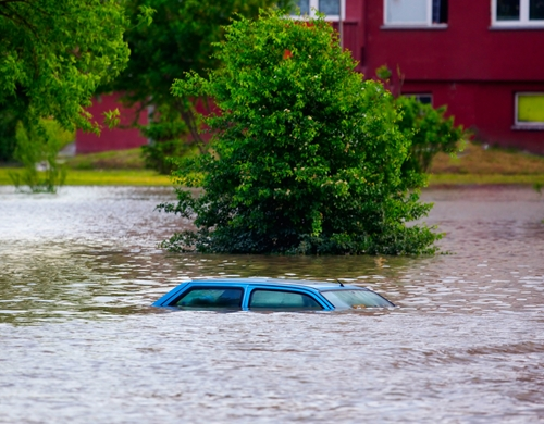 Scientists have correlated greenhouse gas emissions with this year's record floods in Oklahoma and Texas.